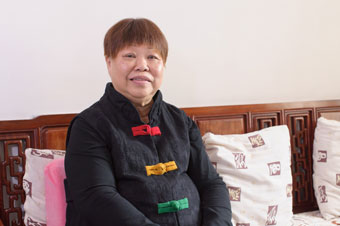 PD patient Ngan Sau Yuk sitting in her living room